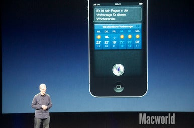 Tim Cook shows off Siri at the Apple press event on Wednesday.