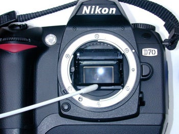 how to get rid of dust inside camera lens